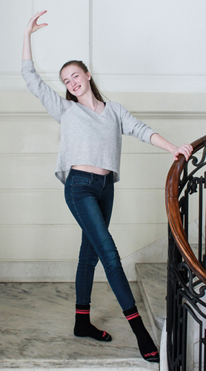 Carolyn Girard '18 poses on the stairs.