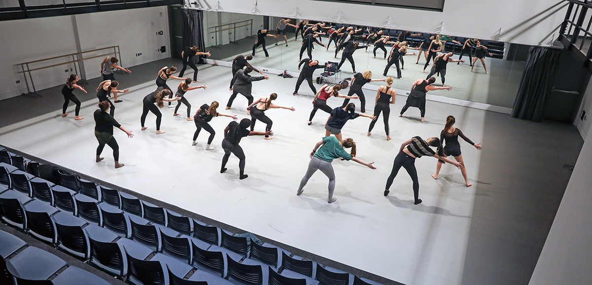 Dancers follow along with Nan Giordano in Exeter's dance studio.
