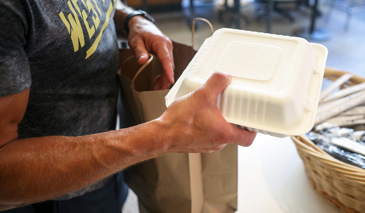 man holds a packaged meal