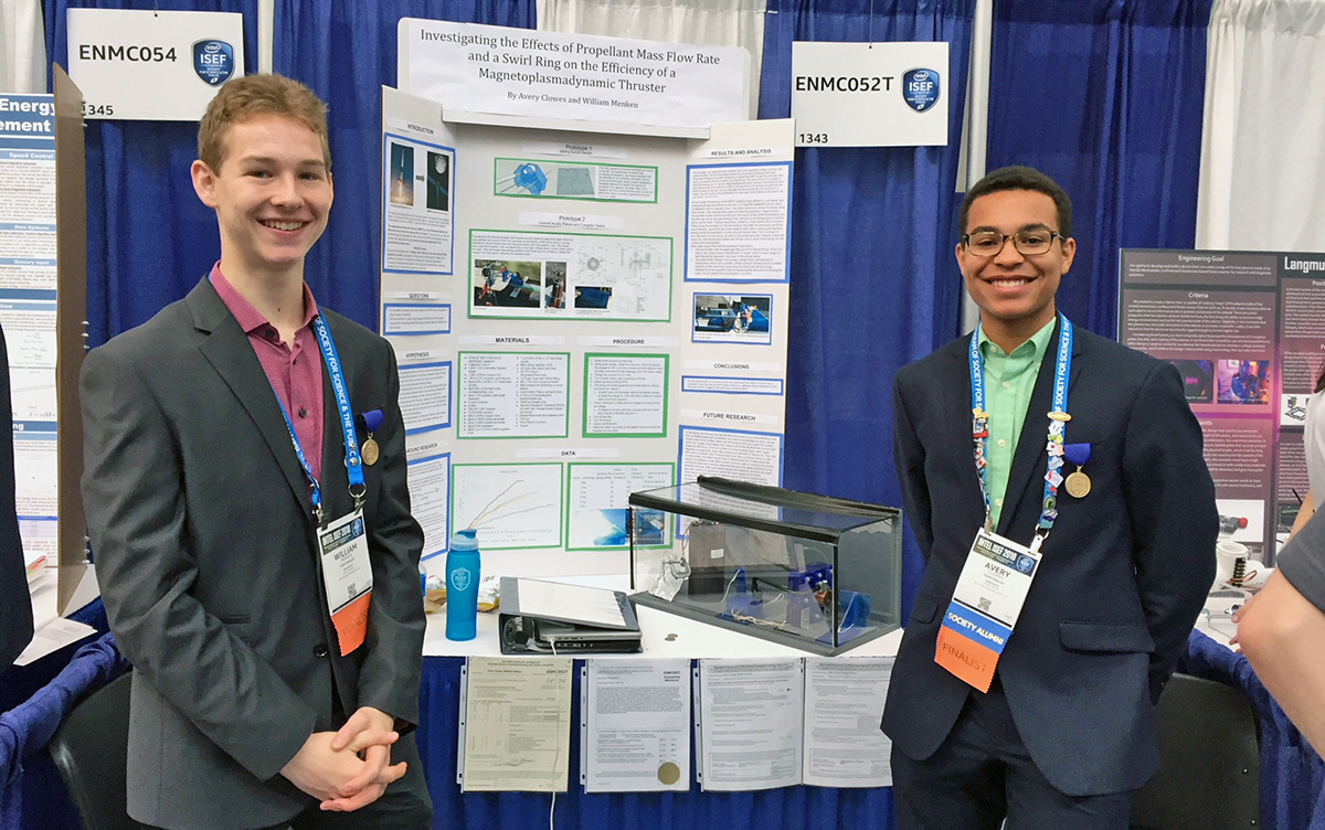 Menken and Clowes present their magnetoplasmadynamic thruster project at the Intel International Science and Engineering Fair in 2018.
