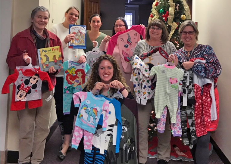 Exeter Finance Department with PJs for tots.