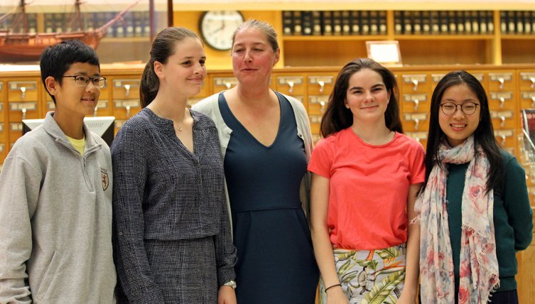 Exonians Blane Zhu, Anne Brandes, Ginny Little and Mai Hoang (left to right) stand with poet Jill McDonough.