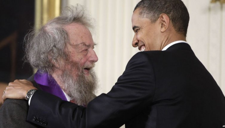 Donald Hall shares a laugh with President Barack Obama in 2010 after being awarded the National Medal of Arts.