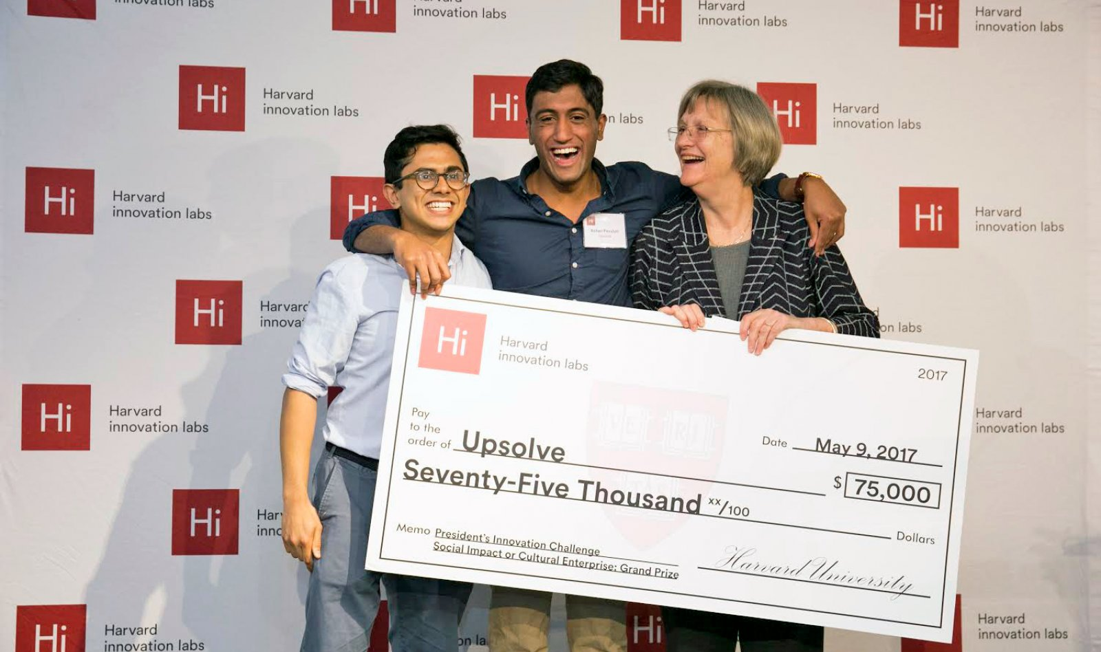 Milton Syed '14 and Rohan Pavuluri '14 accept a prize grant check from Harvard President Drew Faust.