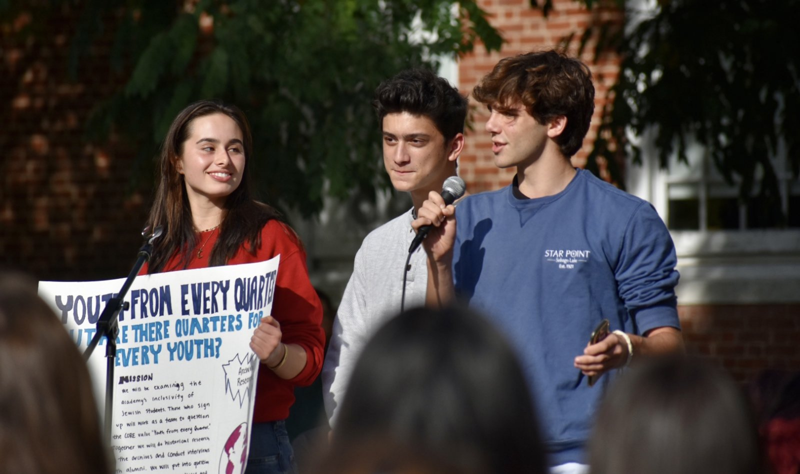 Juliet Ortiz, Niko Matheos and Georgie Venci address the crowd.