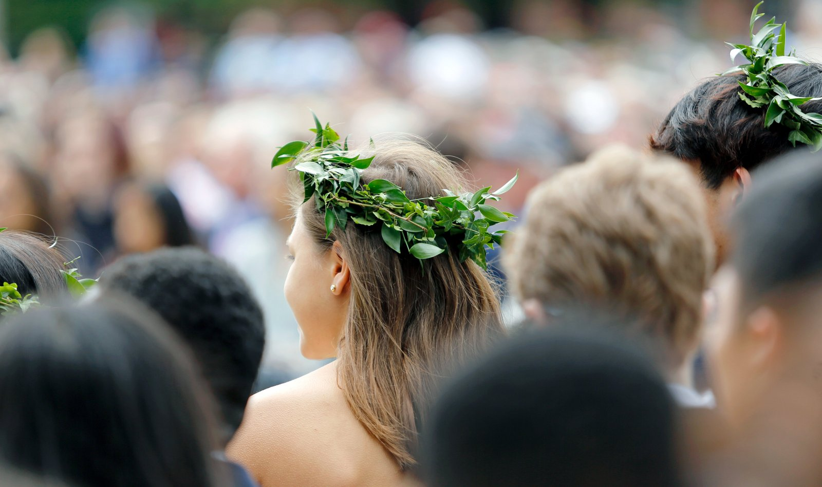 Exeter students wearing wreaths at graduation.