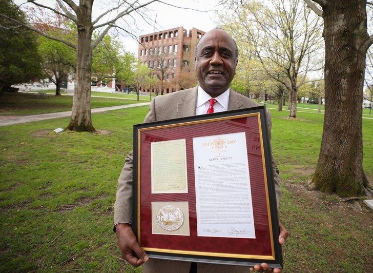 Alan Jones holds his framed Founders' Day Award