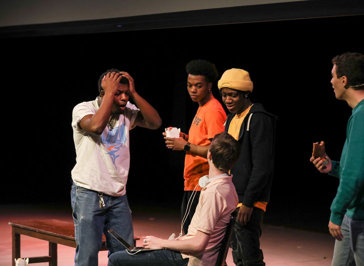 Actors in the play titled Now That We're Men on the main stage at Phillips Exeter Academy.
