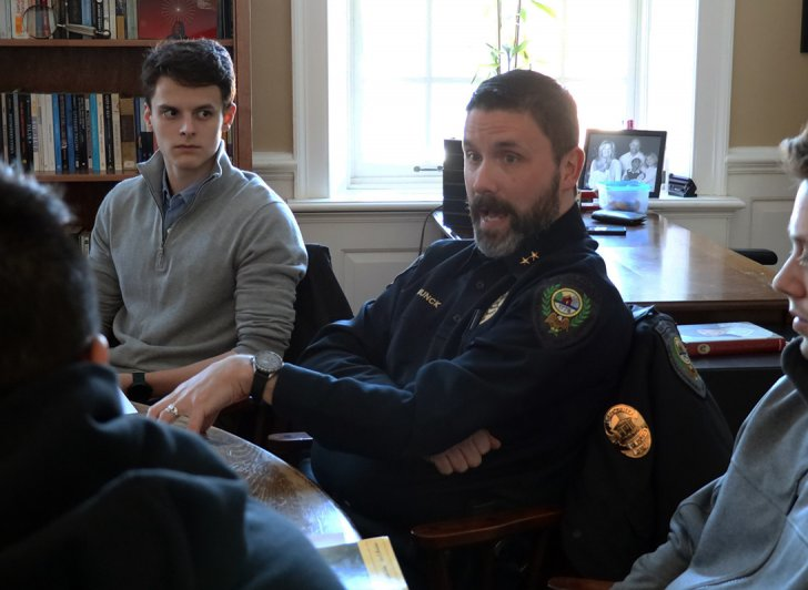 Deputy Chief Michael Munck discussing crime fiction with Exeter students.