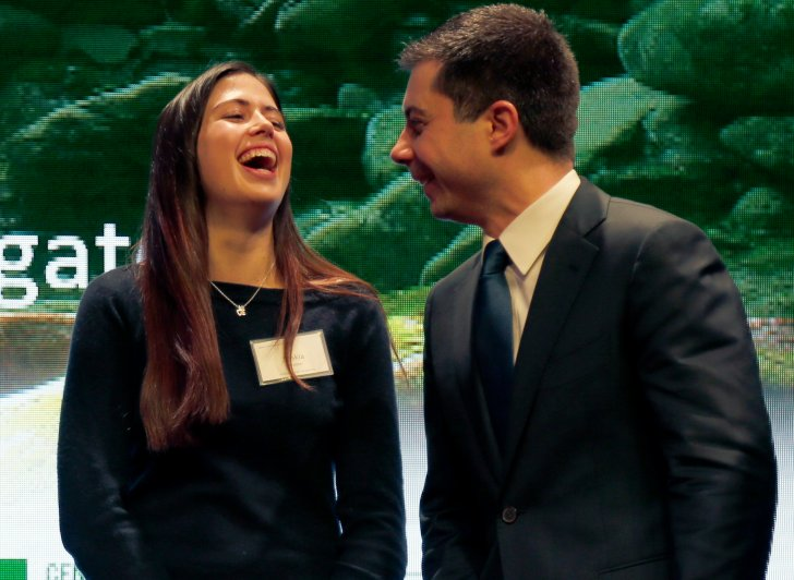 Exeter student laughing as she talks to presidential hopeful Pete Buttigieg.