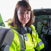 Kerry sitting in the cockpit of a Boeing 737 airplane.