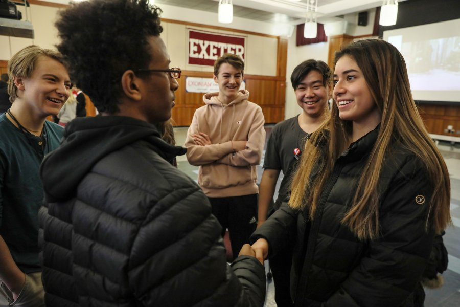 Exeter students greet a speaker at MLK Day 2020.