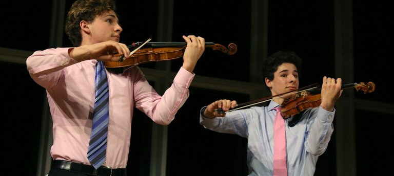 Dacha (left) and Sava Thurber have been playing violin since the age of 3.