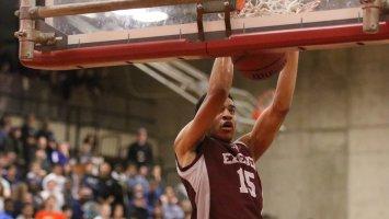 Exeter basketball player dunking a ball
