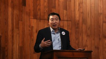 Exeter alum Andrew Yang addresses the assembly at Exeter