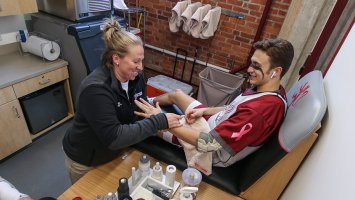 An athletic trainer helping an Exeter athlete in the Bravo Room