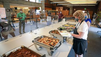 Elm Street dining hall with plexiglass partitions