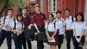 Exeter musicians with a group of students in Vietnam