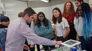 Instructor Andrew McTammany leads a chemistry class