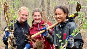 Addison Luce '21, Rachel Saltman '21 and Marymegan Wright '21 show off the fruits of their labor culling invasives from Southeast Land Trust property in Exeter.