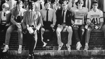 Photo of Eddie Perry and his dorm mates sitting on a wall at Exeter.