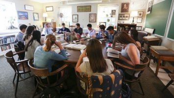 Students in English Instructor Todd Hearon's class sitting around a Harkness table at Exeter