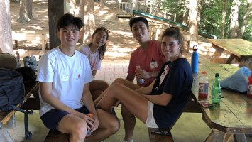 A group of Student Listeners takes a break from team building activities