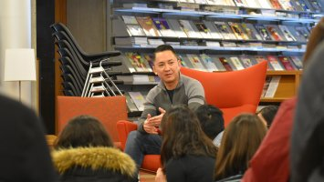Novelist Viet Thanh Nguyen speaking with students in the library at Exeter