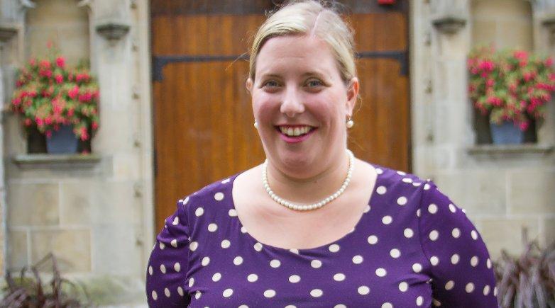 Headshot of Heidi Heath outside Phillips Church.