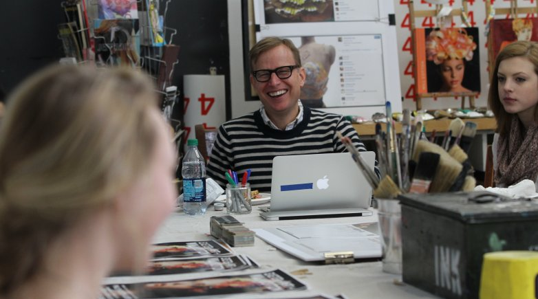 Artist Will Cotton talks to students in an Exeter art studio.