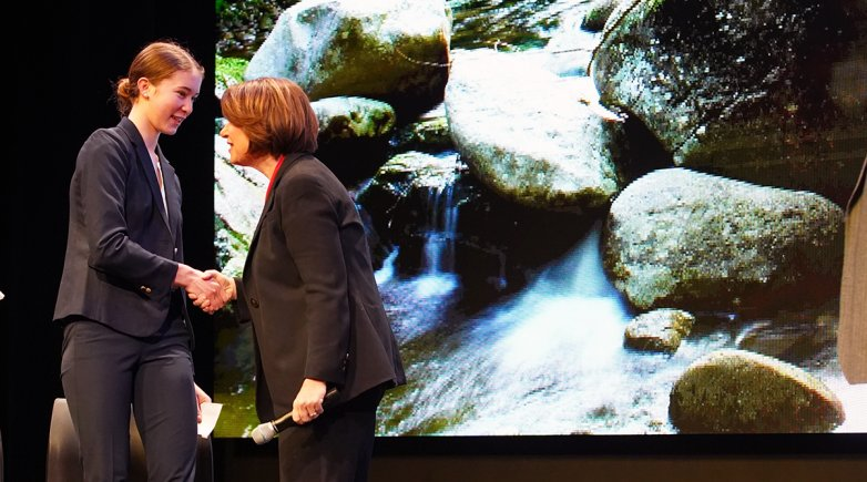 Exeter student Beatrice Burack greets Senator Amy Klobuchar at climate town hall