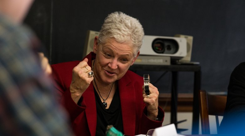 Gina McCarthy talks with students about the history of human interaction with, and destruction of, the environment.