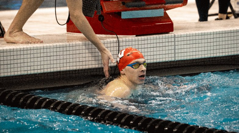 Andrew Benson in the pool at the start of a race