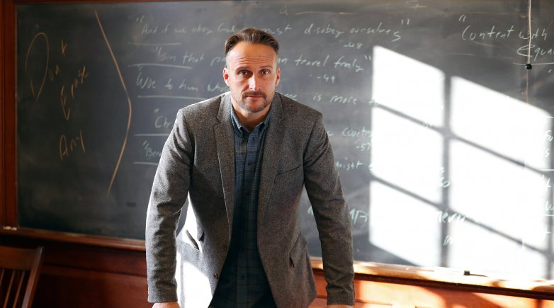 Matt in front of the chalkboard in his Phillips Hall classroom.
