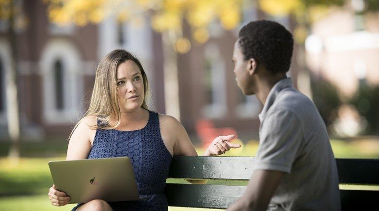 Lauren Josef talks with a student