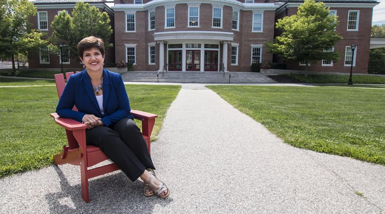 Joanne Lembo sitting outside in front of the Academy Center.