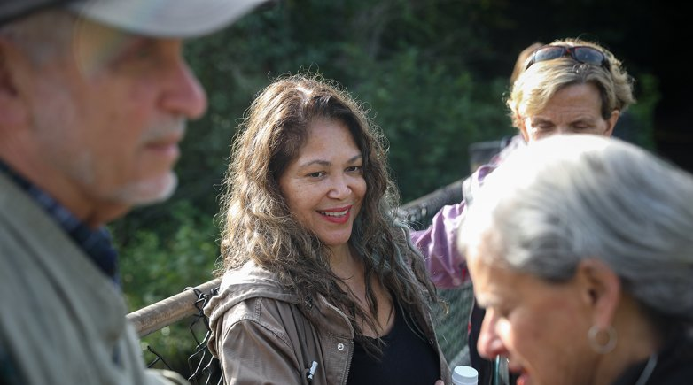 Sandra Guzman chats with her fellow birding society members