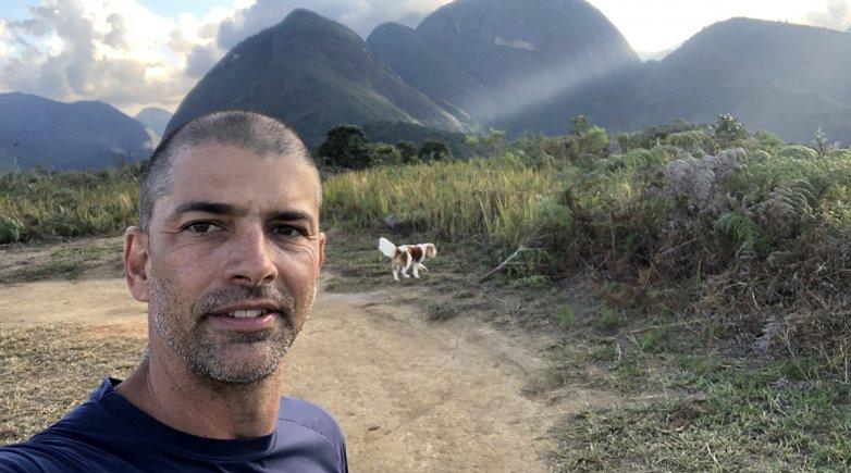 Wolff Klabin standing in front of a mountain range.