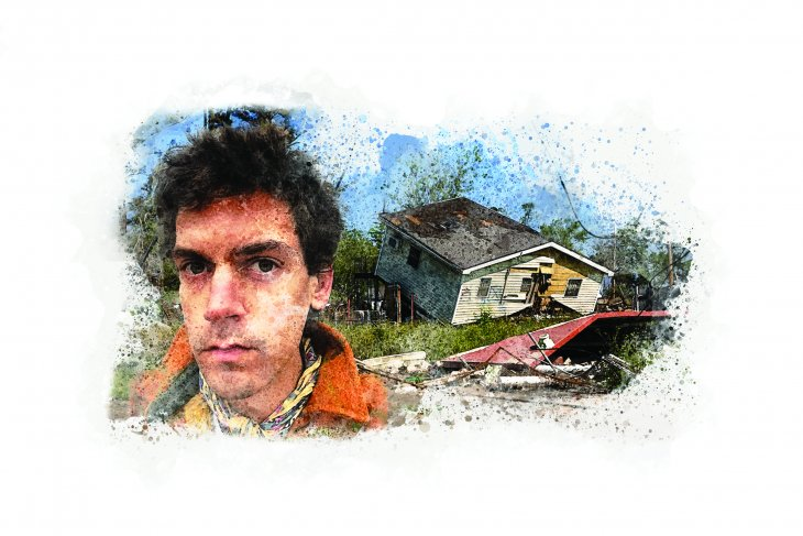 David in front of a home destroyed by hurricane Katrina.