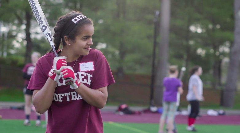 Menat holds a bat at softball practice.