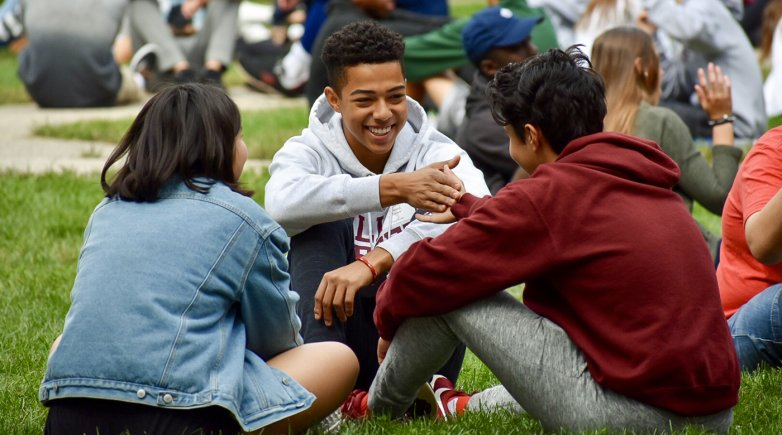 Group of students chatting in the academic quad.